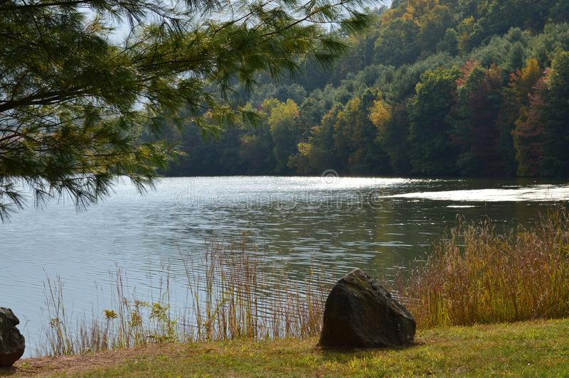 Connecticut Lake III. The beginning of fall colors along a lake in Connecticut during the month of October royalty free stock photos