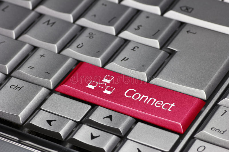 Connecting computers. Red computer key with 3 computers connected. Joined by the word connect. WAN,LAN, Internet royalty free stock photography