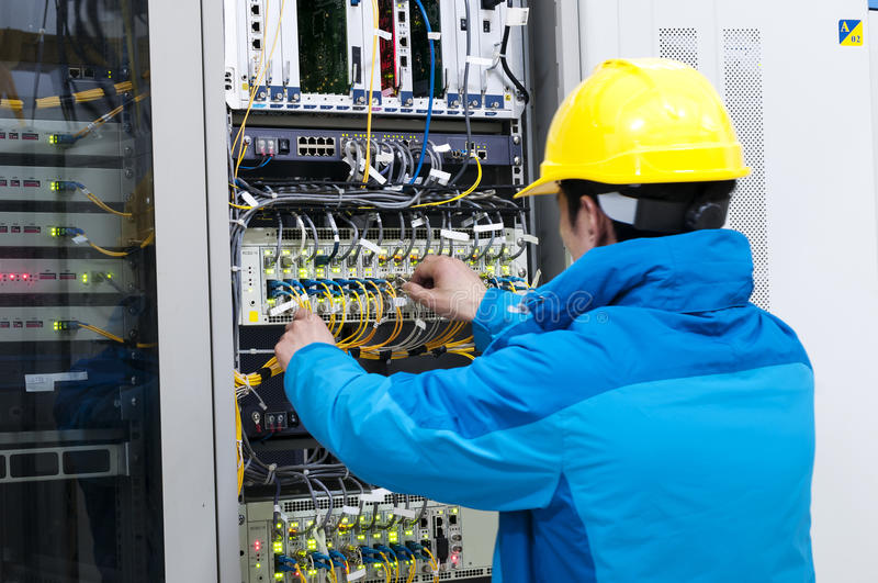 Connecting network cables to switches stock photography