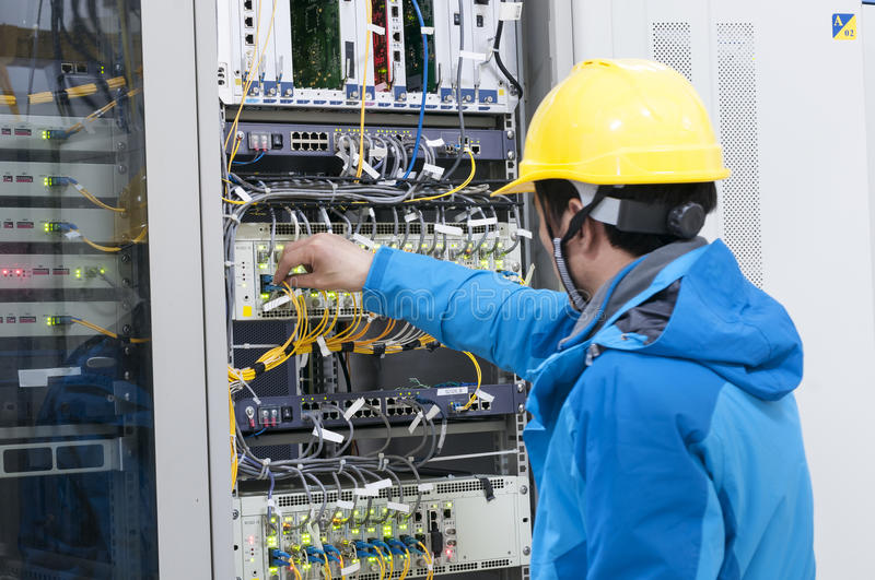 connecting network cables to switches stock images