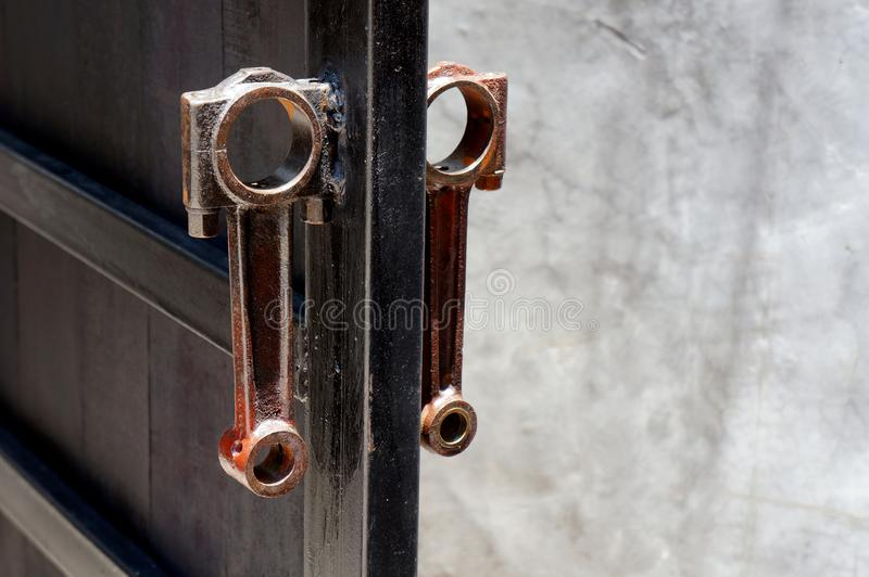 Two of the connecting rod made for handle steel door. stock image
