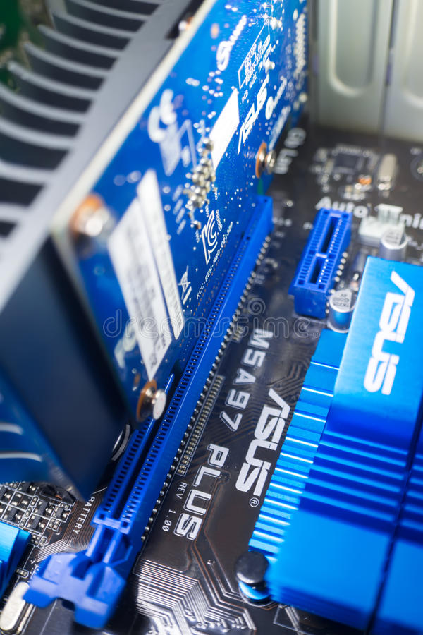 Connecting the video card Asus to the motherboard Asus royalty free stock photo
