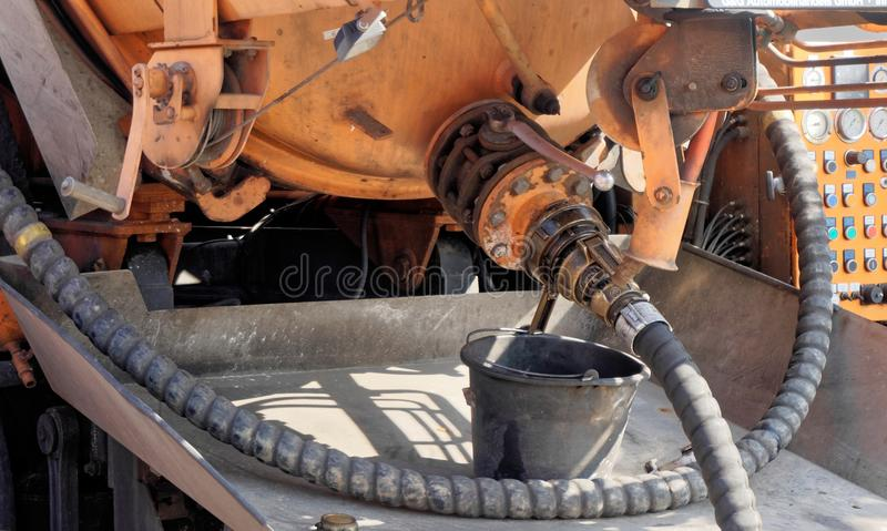 Connection for the hose of a water wagon with a vacuum extraction system for removing water and sludge from the excavation pit. Germany stock photography