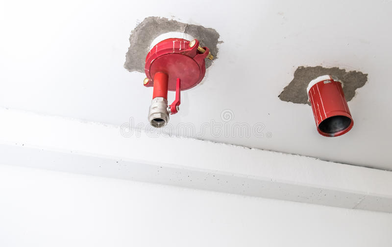 Connection point of an sprinkler system. Connection point of an emergency indoor sprinkler system royalty free stock image