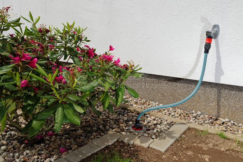 Connection of a water pipeline in a garden stock photos