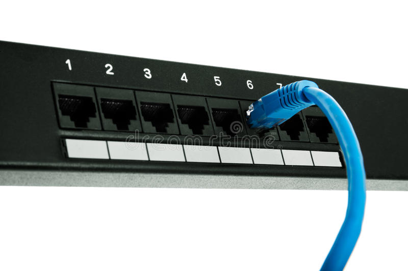 Connector is plugged into patch panel. Isolated over white background stock photography