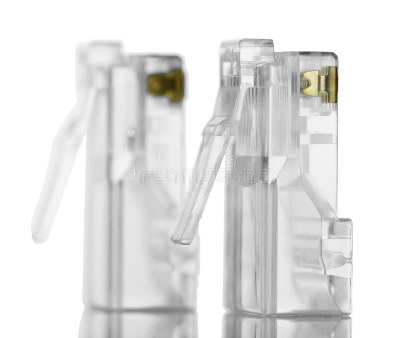 Connettori per il twisted pair rj45 isolati su bianco fotografia stock libera da diritti
