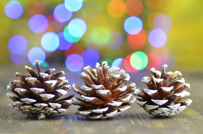 Conos decorativos en fondo mágico del bokeh imágenes de archivo libres de regalías