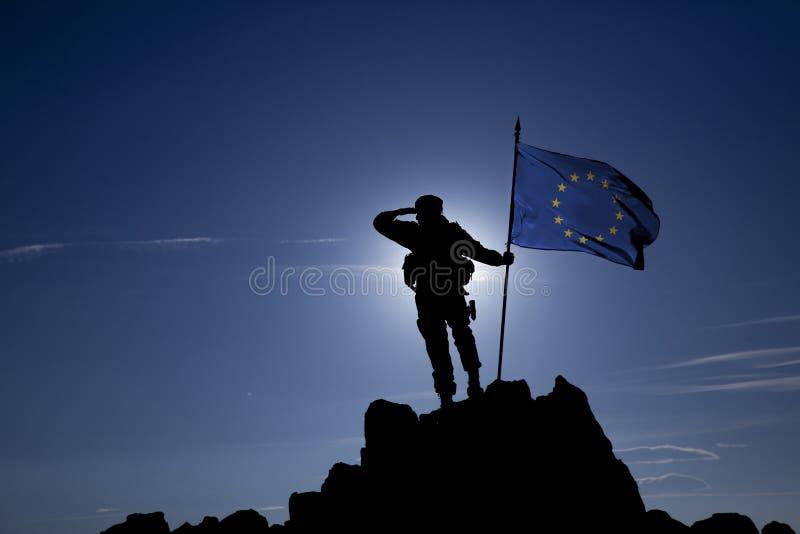 Conquérant avec un drapeau images stock