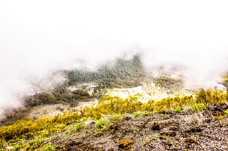 Conquering clouds. Landscape taken from the vesuvio, the clouds capture the colorful landscape in HDR royalty free stock photo