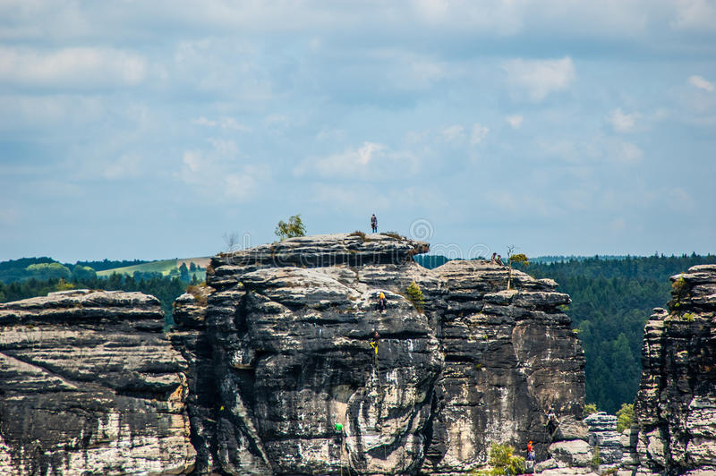 Conquering the height. The Bastei is a rock formation towering 194 metres above the Elbe River in the Elbe Sandstone Mountains of Germany stock images