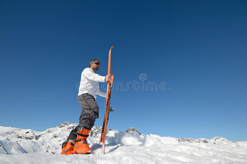 Conquering the summit. Alpinist conquering the summit by ski touring royalty free stock images