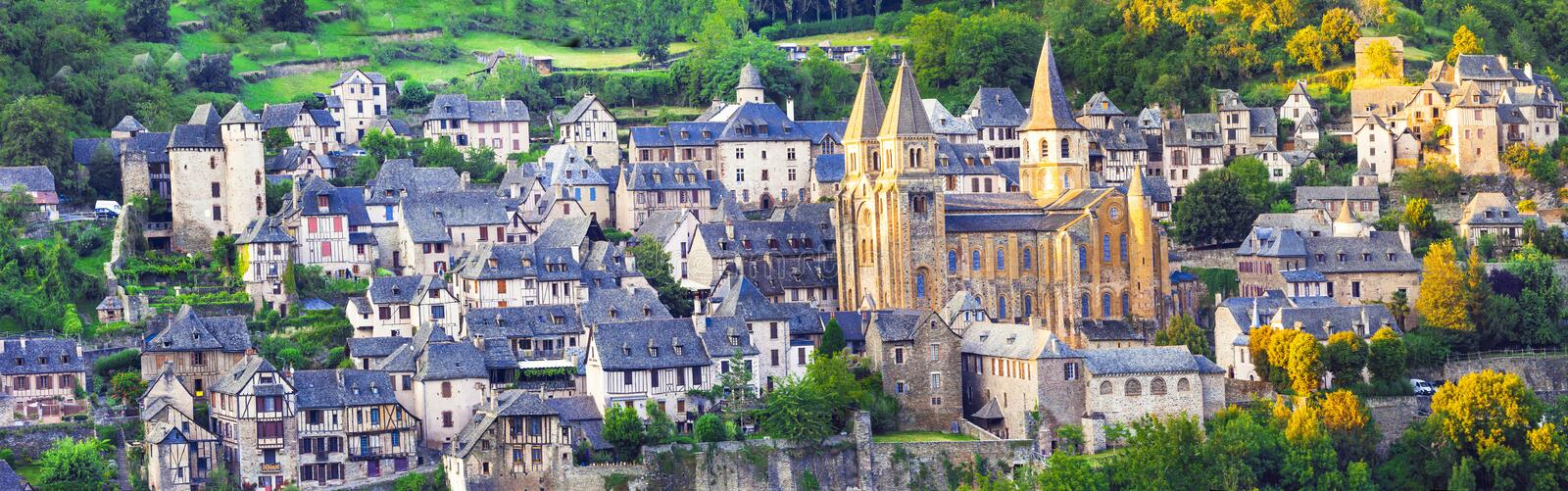 Conques -medieval village and abbey , France. Panorama of Conques medieval village and abbey Saint Foy, France royalty free stock image