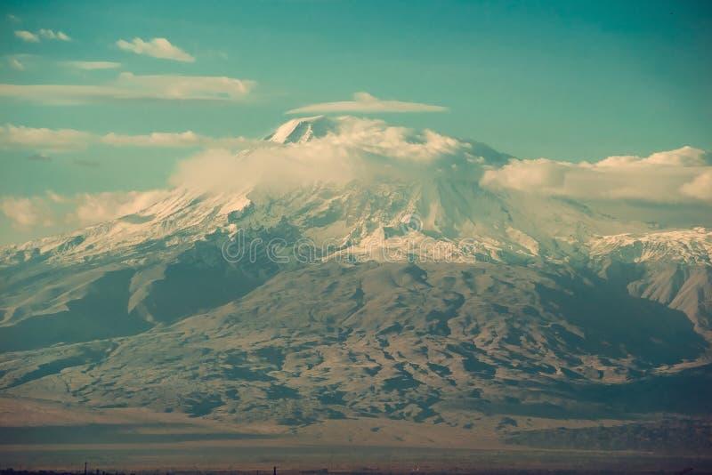 Conquest of peak, achievement concept. Impressive scenic mountain landscape. Big Ararat, Turkey. View point from Yerevan, Armenia. stock photography