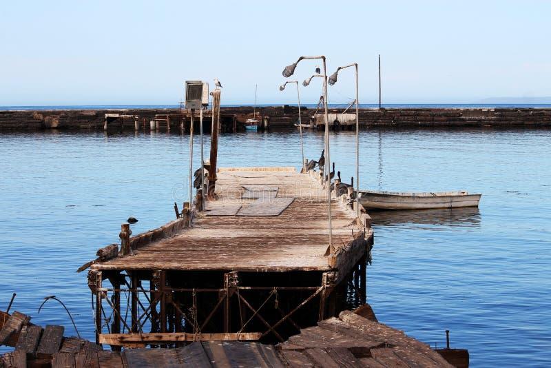 Conséquence d'ouragan : dock cassé image libre de droits