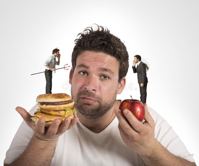Consciência culpada da dieta foto de stock royalty free