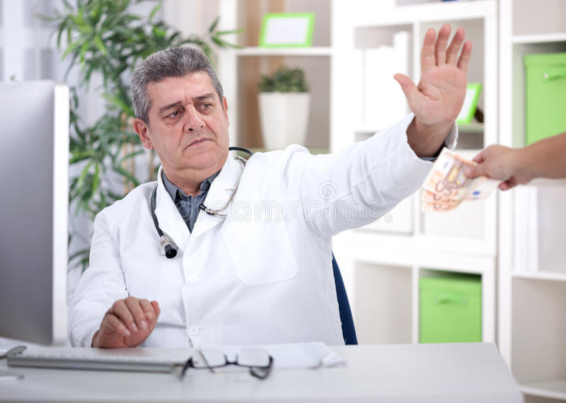 Conscience senior doctor refuses bribes from patients stock images
