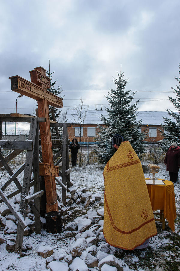 The consecration of the memorial Orthodox cross near the temple in the Kaluga region of Russia. In the Russian Orthodox Church has a tradition of installation royalty free stock photos