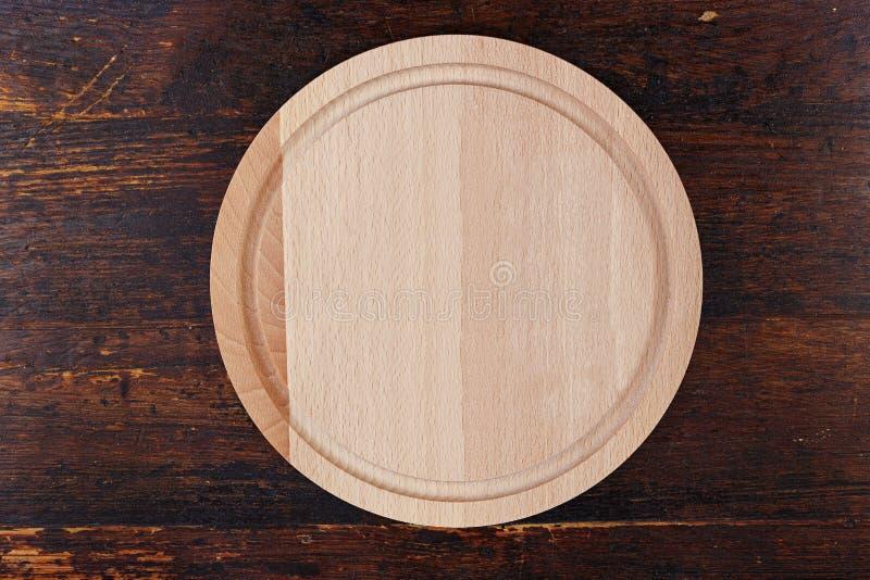 Conseil en bois rond sur un fond en bois photographie stock libre de droits