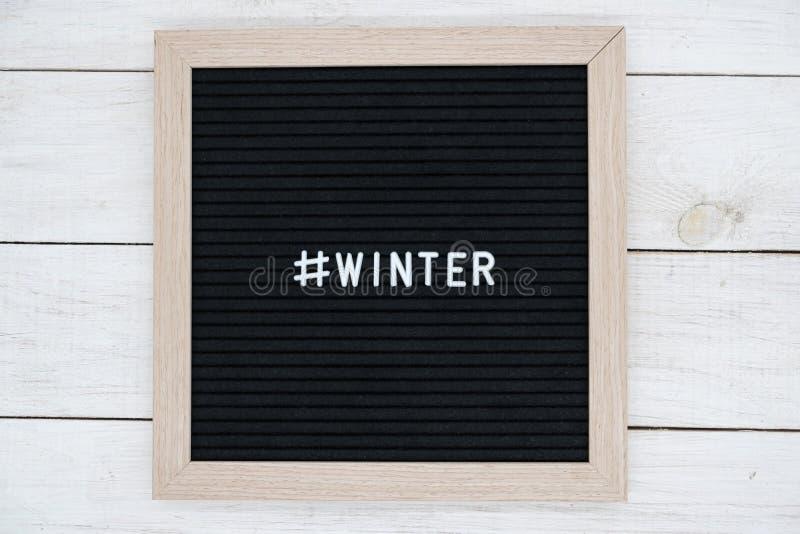 Conseil senti noir avec l'hiver de hashtag et de mot en anglais photographie stock libre de droits