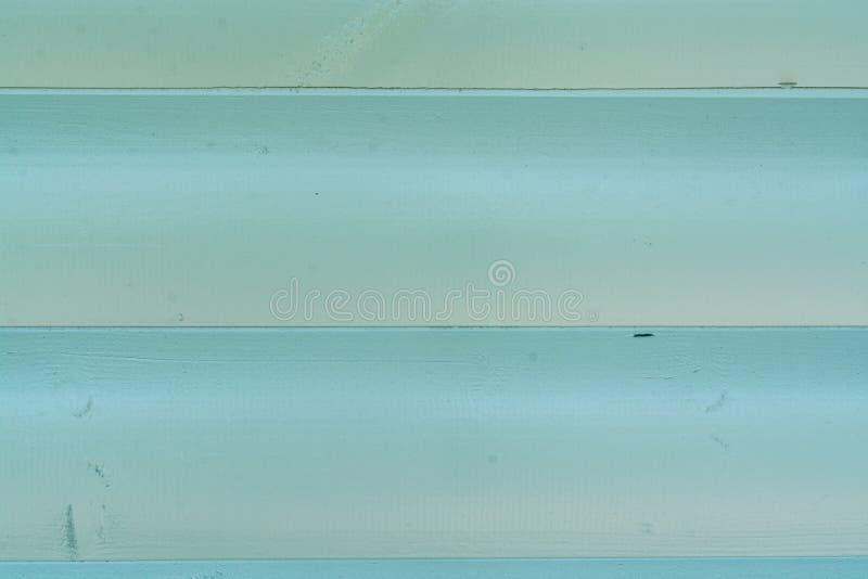 Conseils en bois peints en vert photographie stock