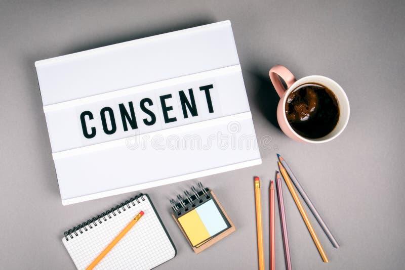 consentement Texte dans le caisson lumineux images libres de droits