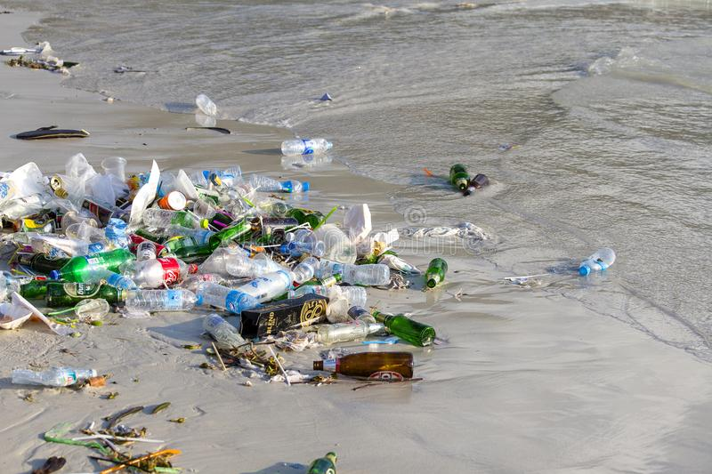 Consequences of sea water pollution on the Haad Rin beach after the full moon party on island Koh Phangan, Thailand. KOH PHANGAN, THAILAND - FEBRUARY 01, 2018 stock images
