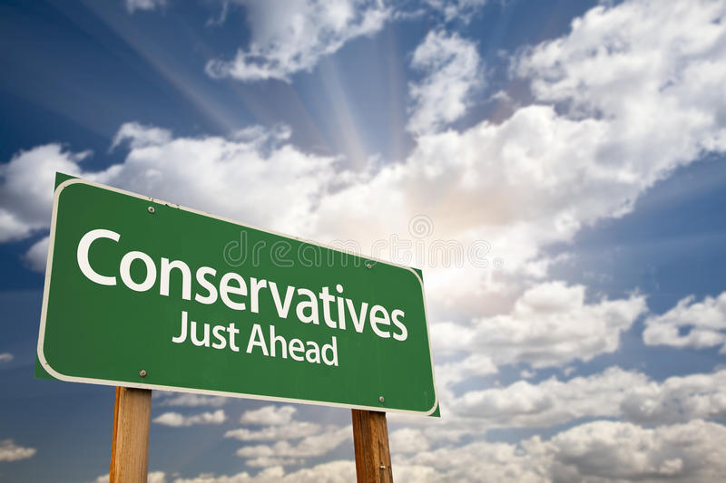 Conservatives Green Road Sign and Clouds. Conservatives Green Road Sign with Dramatic Clouds, Sun Rays and Sky stock photo