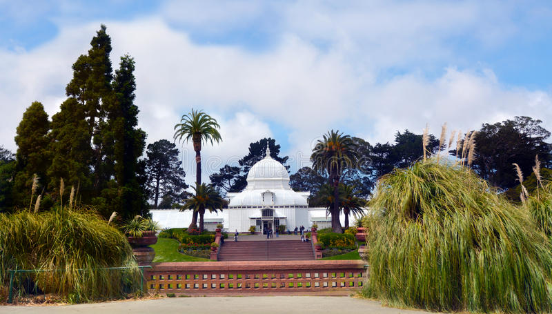 Conservatory of Flowers in Golden Gate Park San Francisco California. SAN FRANCISCO - MAY 21 2015:Visitors at Conservatory of Flowers It's a greenhouse and stock image