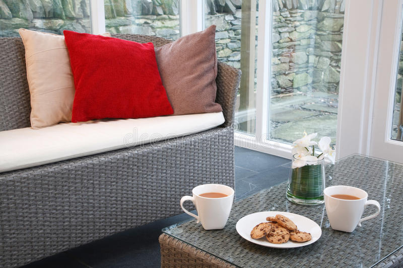 Conservatory interior design. With rattan chairs and coffee table royalty free stock images
