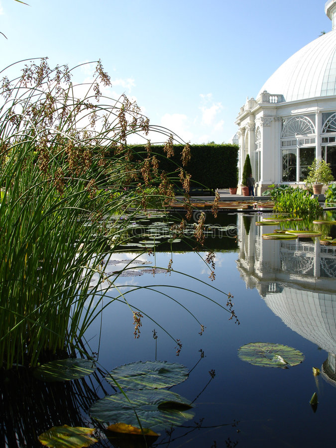 Conservatory reflection in pool royalty free stock photos