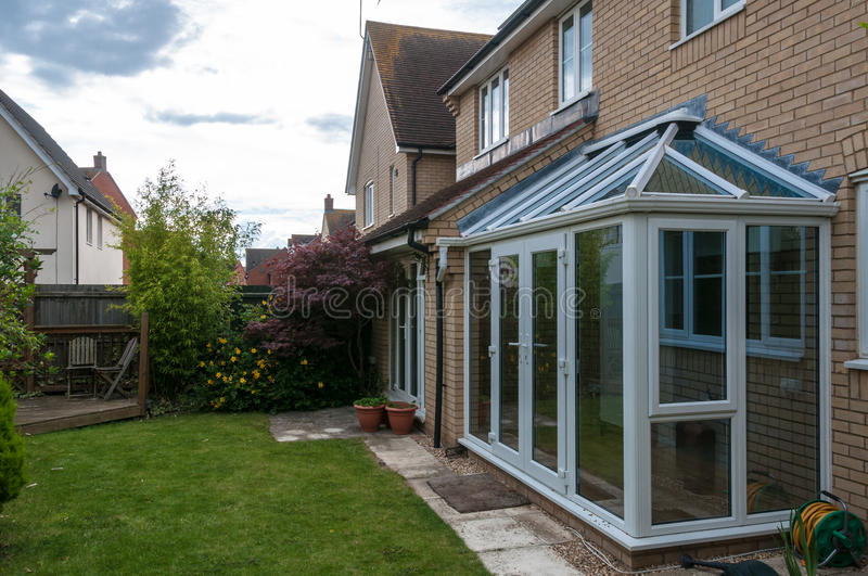 Conservatory and view of back garden, UK royalty free stock images