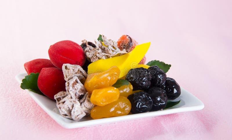 Conserve de fruits et fruits secs Casse-croûte de nourriture sur un fond photos stock