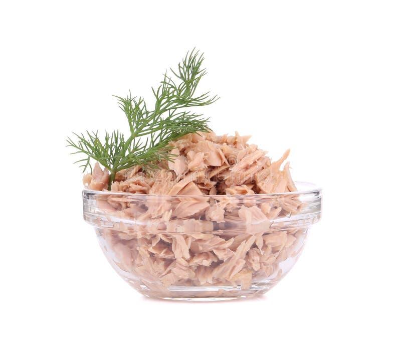 Conserve de thon en bol en verre et aneth image stock