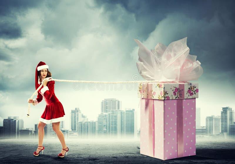 Consiga su regalo de la Navidad fotos de archivo