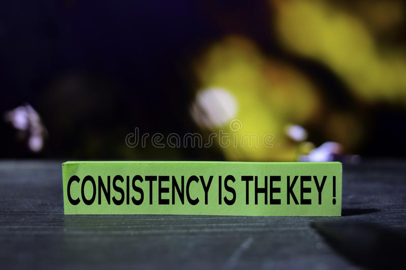 Consistency is the Key on the sticky notes with bokeh background stock images