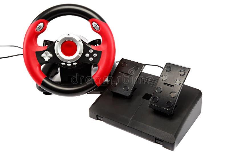 Console do jogo com um volante e os pedais foto de stock royalty free