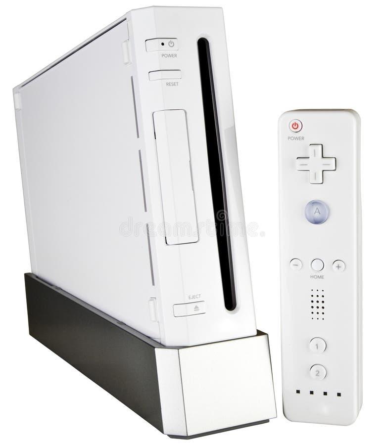Console do jogo video e controlador da mão fotos de stock