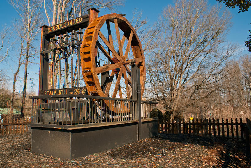 Consolidated Stamp Mill in Dahlonega Georgia. Photo shows historical Consolidated Stamp Mill with wooden water wheel used to crush quartz rock to expose gold and royalty free stock photos