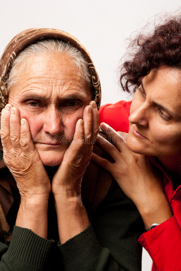 Consoling the elderly stock photos