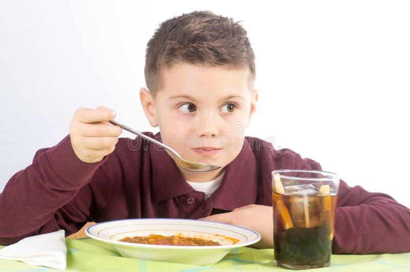 Consommation 4 d'enfant photo libre de droits