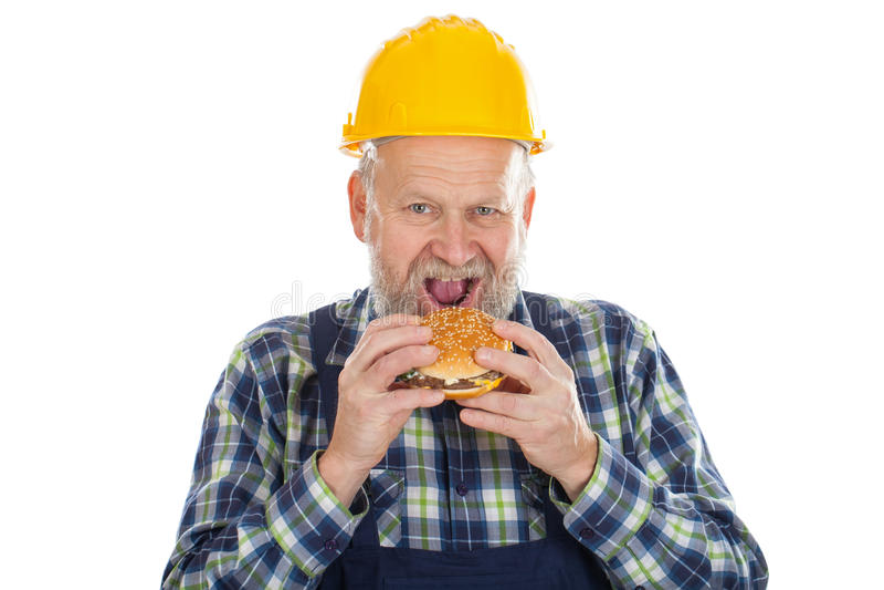 Consommation d'un hamburger savoureux photos libres de droits