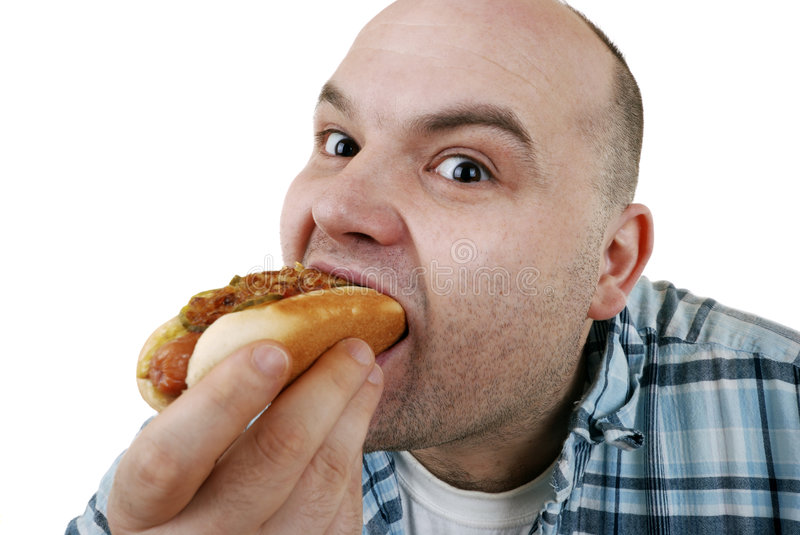 Consommation d'un hot-dog photo stock