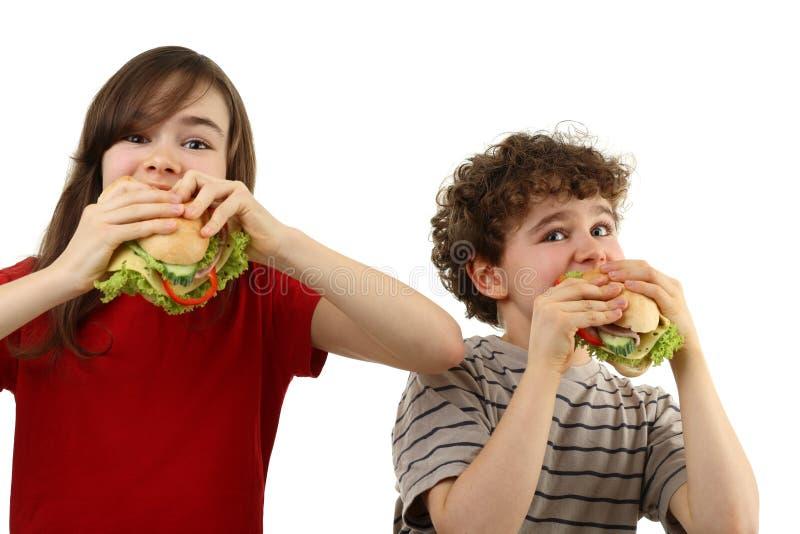 consommation des sandwichs sains à gosses photos libres de droits