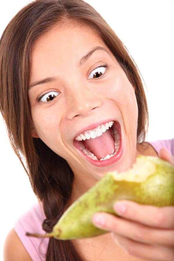 Consommation drôle de fruit image libre de droits