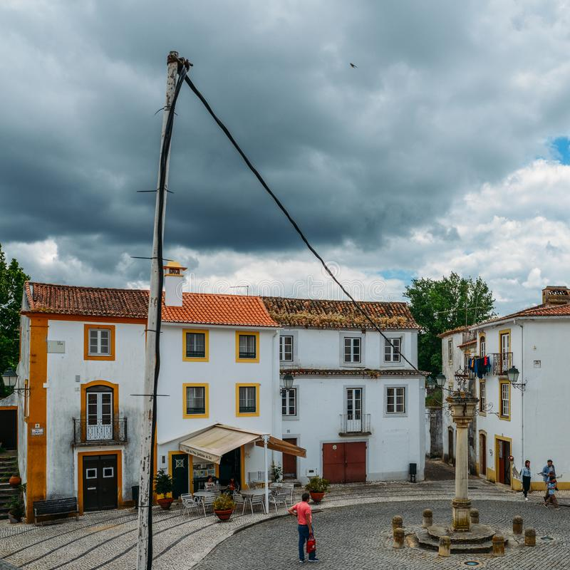 View of narrow main square consisting of limestone cozy yellow and white houses at Constancia in the Santarem District. Constancia, Portugal - June 8th, 2018 stock photos