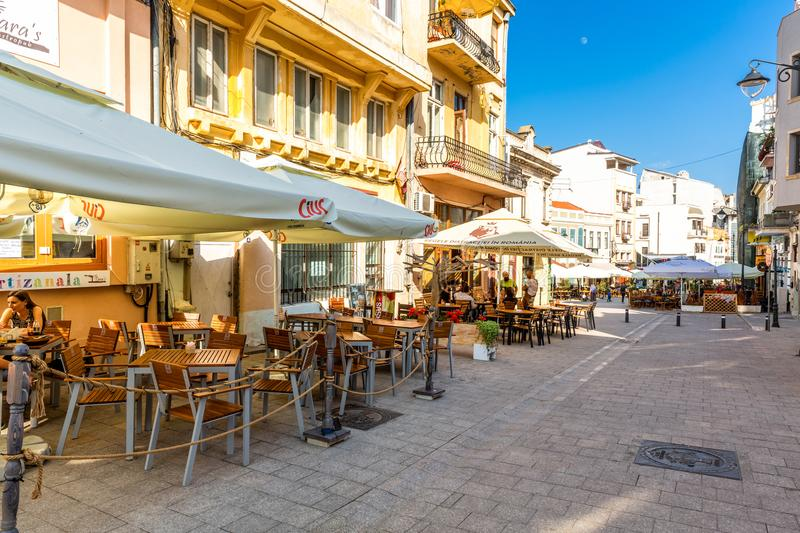 Constanta old town pedestrian street with restaurants and pubs. CONSTANTA, ROMANIA - MAY 24, 2018: Old town pedestrian street with restaurants and pubs stock photography