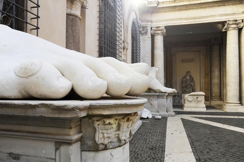 Constantine`s Foot. This is part of what was once a giant marble sculpture of Emperor Constantine. It along, with the other parts. Are in the courtyard of the royalty free stock photo
