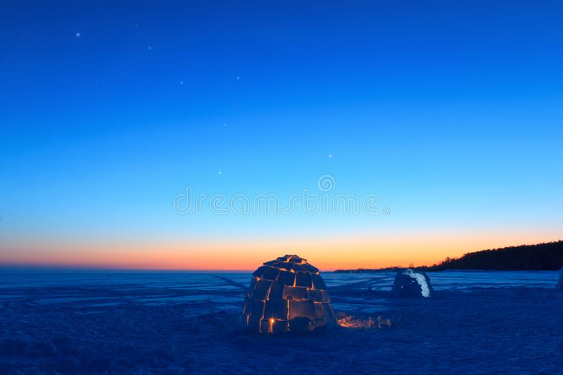 The constellation of the Great Bear over the snowy dwelling of the Eskimos - igloo. royalty free stock images