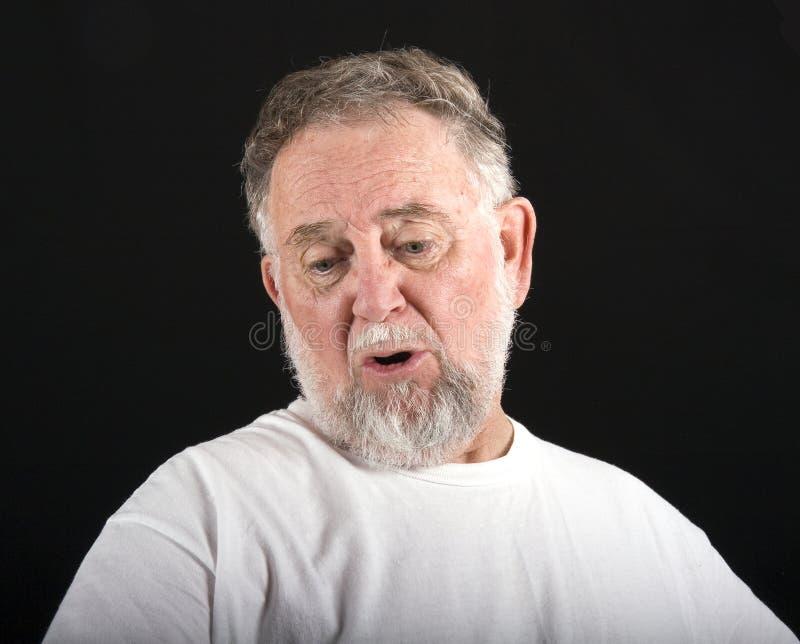 Consternação do homem idoso fotos de stock